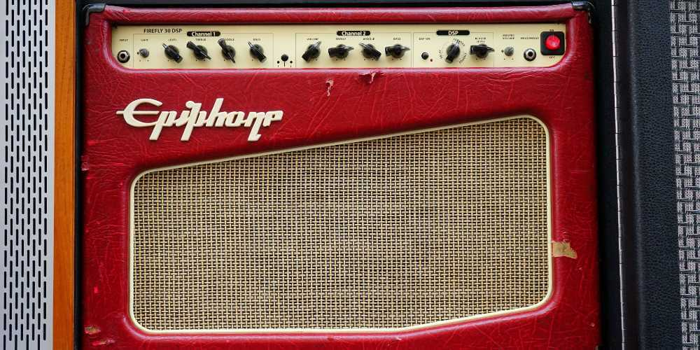 How can I stop my guitar amp from picking up the radio