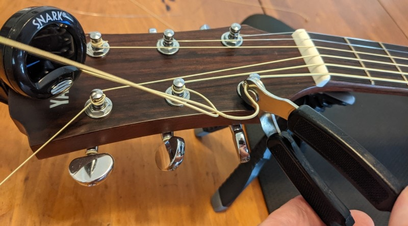 How to Restring an Acoustic Guitar - cut off slack