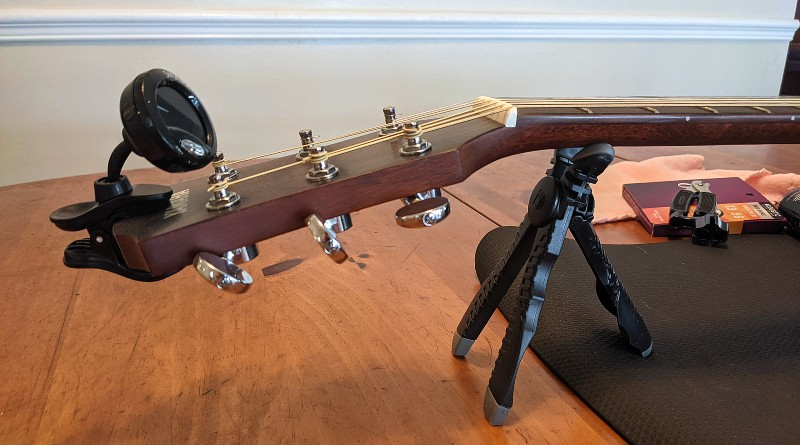 How to Restring an Acoustic Guitar - Support the neck