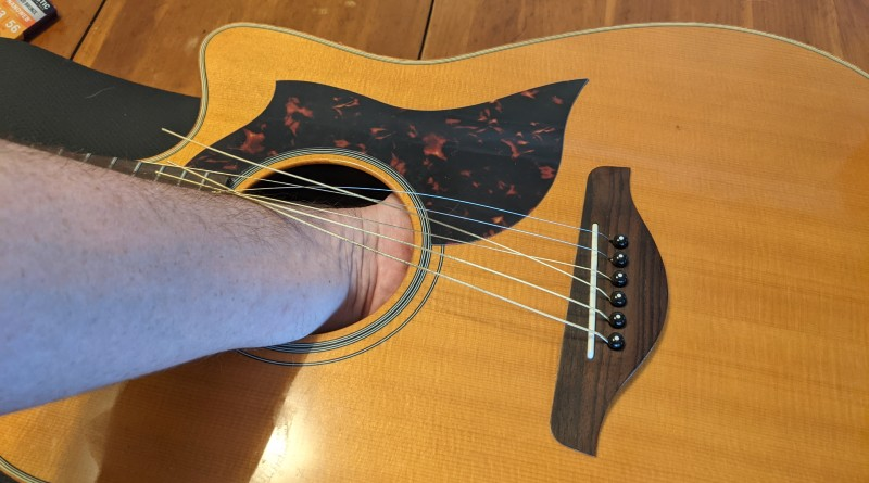 How to Restring an Acoustic Guitar - remove bridge pins from the back