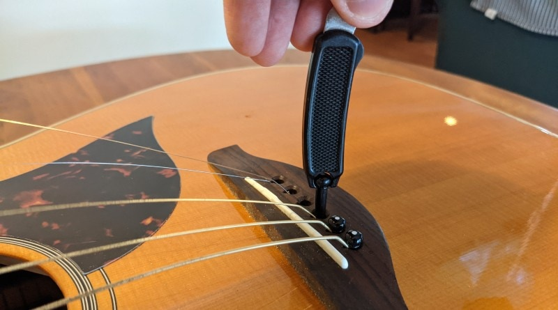How to Restring an Acoustic Guitar - remove bridge pins with a tool