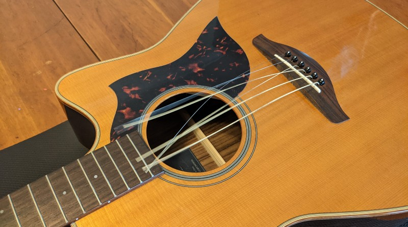 How to Restring an Acoustic Guitar - take off the old strings