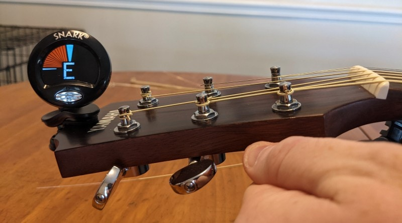 How to Restring an Acoustic Guitar - tune strings again